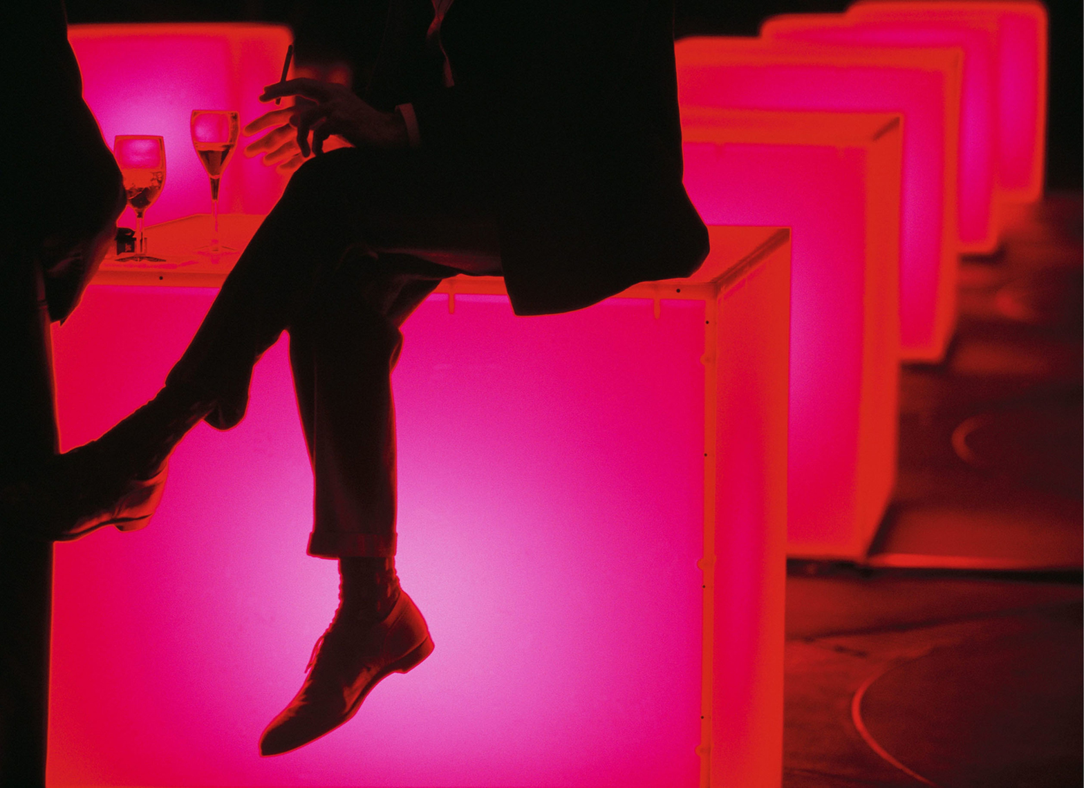 Man on glowing table at Guggenheim party